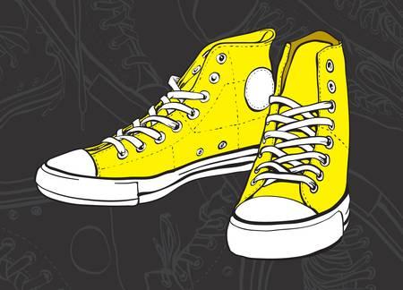 Yellow sneakers on dark background