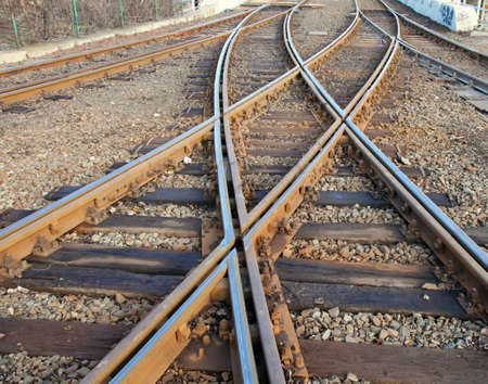railroad track: Closeup photo about interwaved rails. Stock Photo