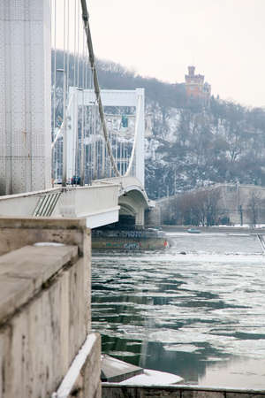Elisabeth bridge over the Danube in winter in  Budapest, Hungary  Ice sheets on the Danube  photo