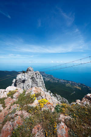 View of Yalta city, pine woods, Ayu-Dag mountain and Black sea from the top of Ai-Petri plato, Crimea, Yalta region Stock Photo