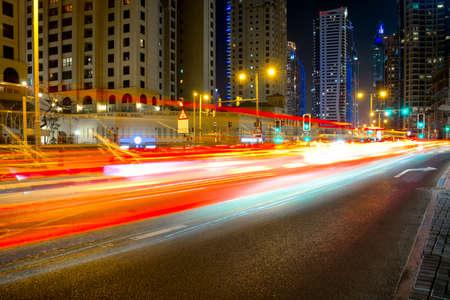 City road night scene, UAE, Dubai, Night traffic long tracers in Dubai UAE center