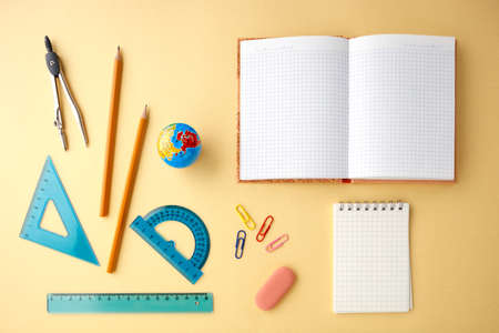 Back to school concept on yellow texture paper background.