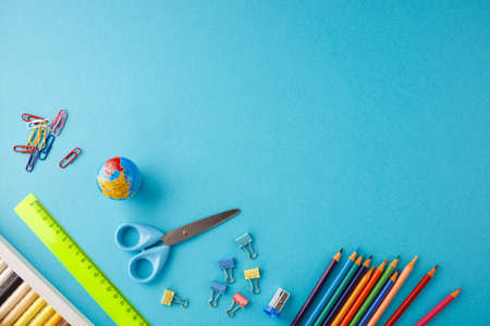 Back to school concept on blue texture paper background.