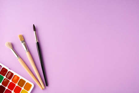 Back to school concept on violet texture paper background. Stock Photo