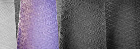 Colorful reels of threads. web banner background