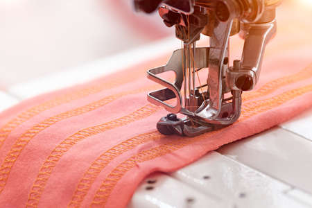 technology, manufacturing, handcraft concept. close up of the most important details in sewing machine