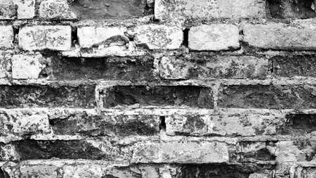 brick wall of black and white color, wide panorama of masonry