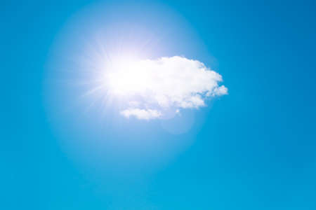 Sun and white cloud in the blue sky, sky background with space for text web banner