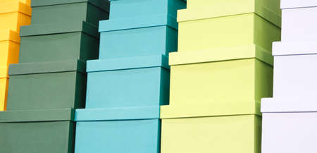 A pile of colorful boxes, gift concept congratulatory background, web banner Banco de Imagens