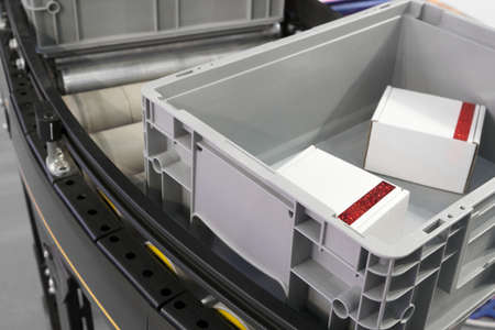 Plastic Crates at Conveyor Rollers in Factory Production or warehouse storage and sorting Banco de Imagens