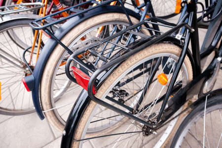 Group of bicycles parking. Sport concept with bicycle. Pile of bikes in the street of Stockholm city. Selective focus Reklamní fotografie