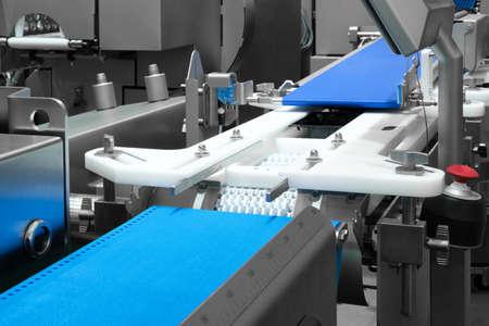 Empty conveyor belt of production line, part of industrial equipment Imagens