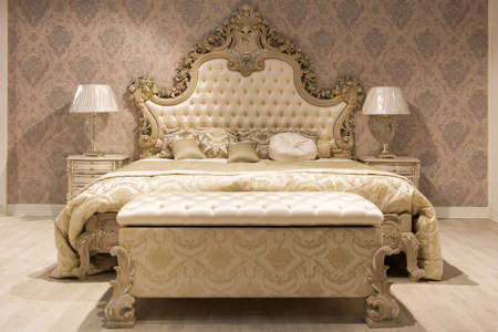 Luxurious bedroom with bed and bedside tables and a mirror. Concept interior, home, comfort, hotel.