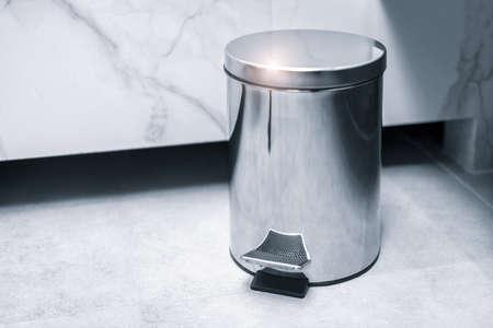 Trash bin in a bathroom, cleaning concept