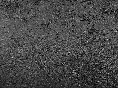 Trama grigia di asfalto bagnato sulla strada, trama di asfalto bagnato