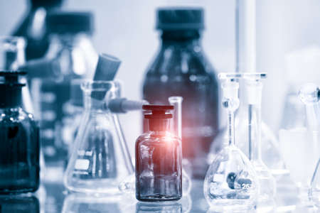 Glass laboratory chemical test tubes with liquid for analytical, medical, pharmaceutical and scientific research concept.