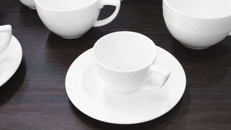 empty white tea cup on black table 免版税图像