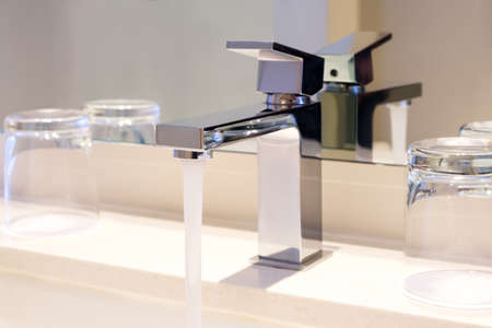Luxury modern style faucet on a white sink in a beautiful bathroom