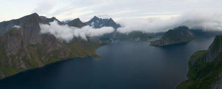 Travel concept with aerial panorama of Norwegian fiords with sea and mountains Stock fotó - 161328537