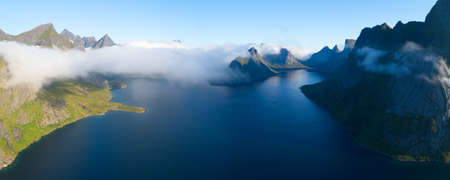 Travel concept with aerial panorama of Norwegian fiords with sea and mountains Stock fotó