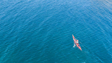 Aerial drone photo of red sport canoes as shot from above in turquoise clear sea Stock fotó - 161398423