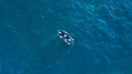 Aerial top view photo of fishing boat Stock fotó