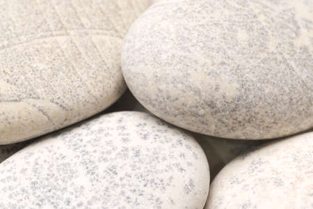abstract background with dry round gray reeble stones, gray close-up pebbles background, spa relaxation concept Stock fotó