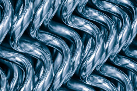 Abstract background from curved heating tubes for industrial and home water supply. Industrial metal concept