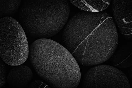 Dark black abstract smooth round pebbles sea texture background Stock fotó