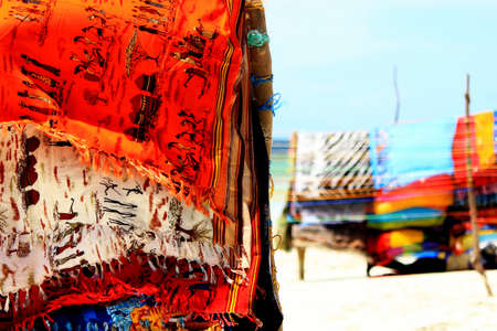 Colorful scarves on sandy beach, Kenya photo