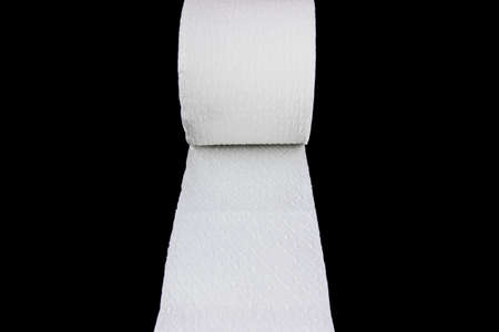 White toilet paper roll isolated on black background photo