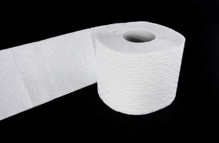 aslant: White toilet paper roll isolated on black background Stock Photo