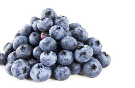 Pyramid of fresh blueberries isolated on white background Foto de archivo