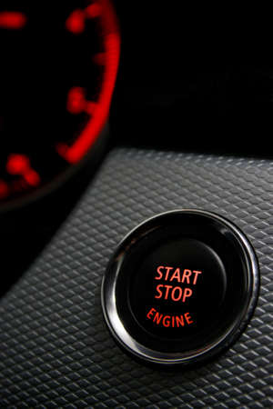 Start Stop engine button in sport car  photo