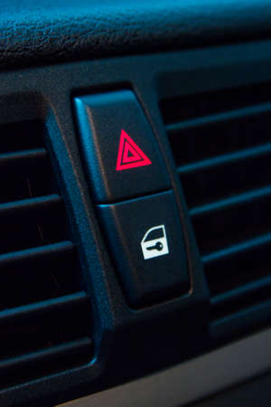 Hazard lights and door lock buttons photo