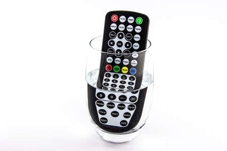 remote controls: Waterproof TV remote control in a glass of water  Stock Photo