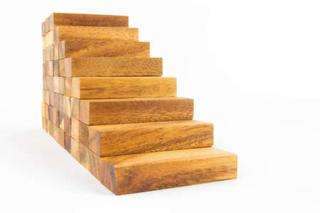 Wooden staircase construction isolated on white background photo