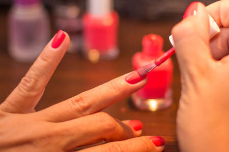 Red finger nails painting photo