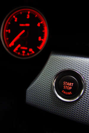 Start Stop engine button in sport car photo