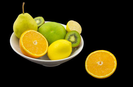 Juicy fruits isolated on black background photo