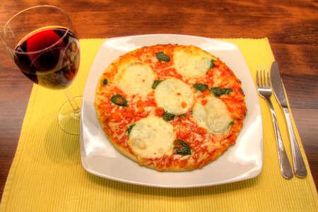 Mozzarella and spinach pizza photo