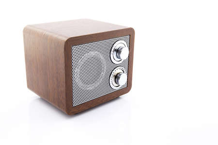Retro style mini radio player isolated on white background photo