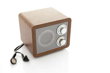 Retro style mini radio player isolated on white background photo