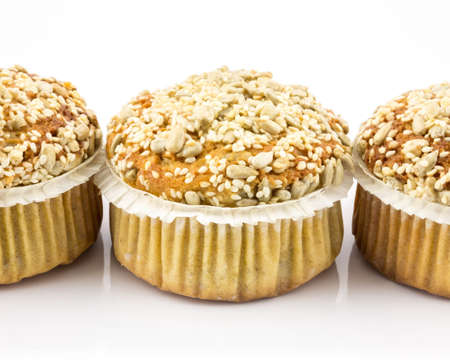Spelt muffins with sesame and grains isolated on white background photo