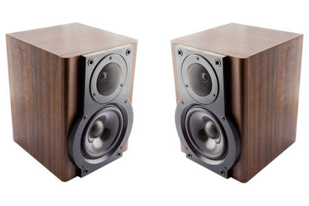 Pair of modern music speakers in classic wooden casing isolated on white background photo