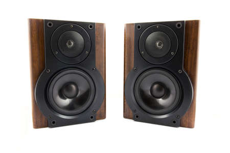 two party system: Pair of modern music speakers in classic wooden casing isolated on white background Stock Photo
