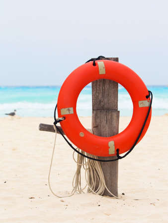 mexico beach: Life buoy attached to a wooden post at the beach in Mexico