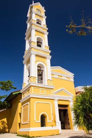 Beautiful old Spanish church and bell tower near Playa del Carmen, Mexico photo