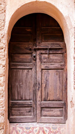 Old Arabian door in Medina village, Morocco photo