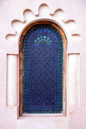 Arabian stained glass window in Medina, Morocco photo